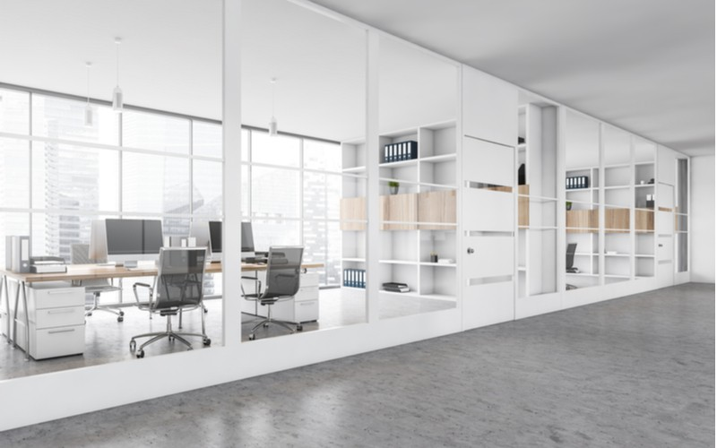 How can glass office partitions improve employee health